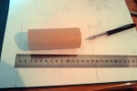 Measure the paper you want to glue around your tube. Leave anough paper at both ends so that you can tuc kit in - results a neater finished edge.